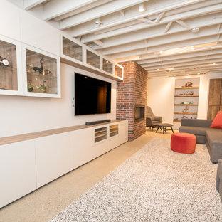 Idées déco pour un grand sous-sol industriel enterré avec un mur blanc, béton au sol, une cheminée standard et un manteau de cheminée en brique.