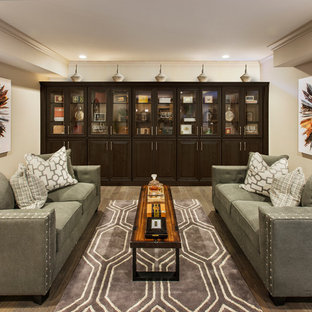 Example of a mid-sized transitional underground medium tone wood floor and gray floor basement design in Philadelphia with beige walls