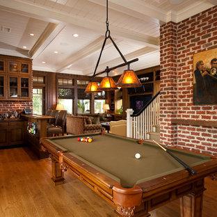 Mountain style medium tone wood floor basement photo in Charleston