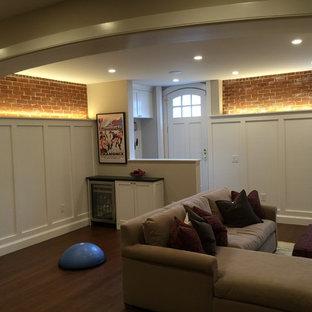 Idées déco pour un sous-sol classique donnant sur l'extérieur et de taille moyenne avec un mur blanc, un sol en bambou, une cheminée standard et un manteau de cheminée en brique.