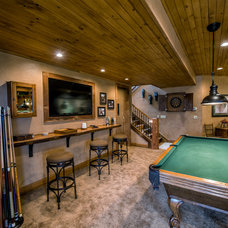 Rustic Basement by Cabinet Concepts by Design