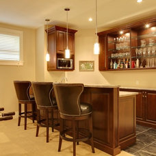 Traditional Basement by Caniela Design