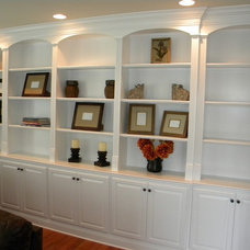 Traditional Basement by Elias Construction