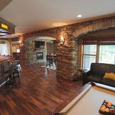 Rustic Basement by Aspen Homes Inc