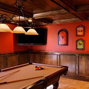 Cette image montre un sous-sol traditionnel de taille moyenne avec un mur rouge, un sol en carrelage de céramique et un sol orange.