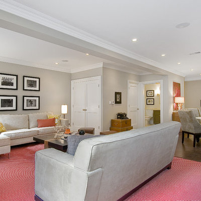 Example of a classic underground basement design in San Francisco with gray walls and no fireplace