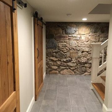 Farmhouse basement with handmade barn doors.