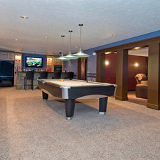 Traditional Basement by Artisan Building and Design, LLC