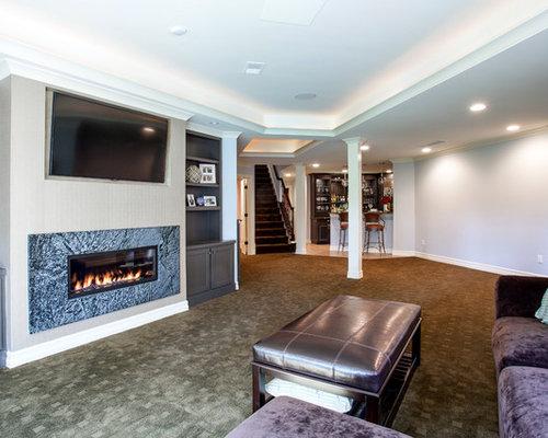 Basement fireplace houzz - Como decorar un salon con chimenea ...