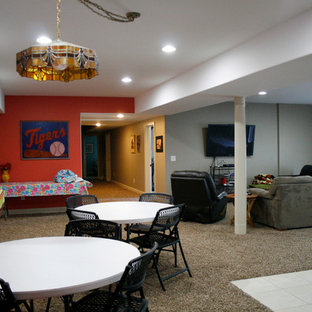 Example of a huge trendy walk-out carpeted basement design in Detroit with orange walls