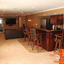 Traditional Basement by Blue Moon Construction