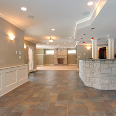 Traditional Basement by Cypress Hill Development LLC