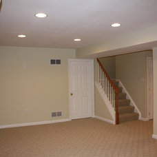 Traditional Basement by Eppinette Construction LLC