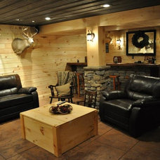 Rustic Basement by Eppinette Construction LLC
