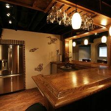 Modern Basement by Renovations by Garman LLC