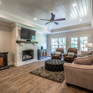 Basement - mid-sized traditional walk-out ceramic floor and brown floor basement idea in Atlanta with gray walls, a standard fireplace and a brick fireplace