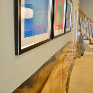 Inspiration for a large contemporary walk-out basement in Raleigh with blue walls, carpet and beige floor.