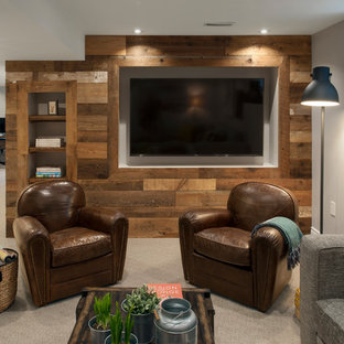 Example of a large mountain style look-out carpeted and beige floor basement design in Toronto with gray walls
