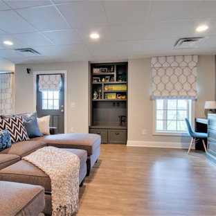 Example of a large transitional walk-out medium tone wood floor and brown floor basement design in Nashville with white walls