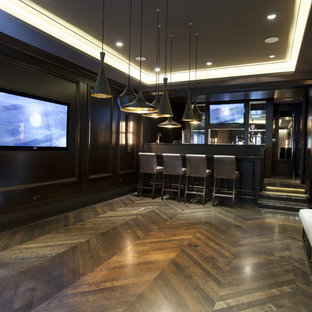 Example of a trendy underground dark wood floor and brown floor basement design in Chicago with no fireplace
