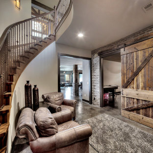 Design ideas for an arts and crafts basement in Kansas City with grey floor.