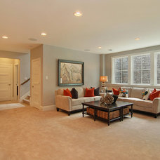 transitional basement by Great Neighborhood Homes