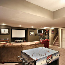 Contemporary Basement by Rococo Homes Inc