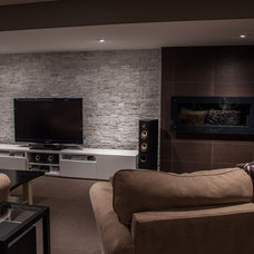 Modern Basement by Allen Interiors & Design Center Inc