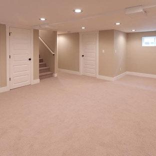 Example of a classic beige floor basement design in Portland