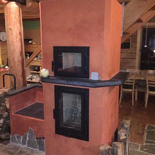 Aménagement d'un sous-sol sud-ouest américain avec un poêle à bois.