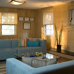 Example of an eclectic look-out basement design in DC Metro with beige walls