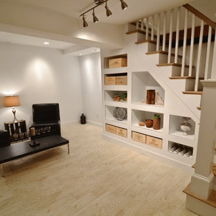 Example of a mid-sized mountain style underground light wood floor and brown floor basement design in Boston with white walls and no fireplace