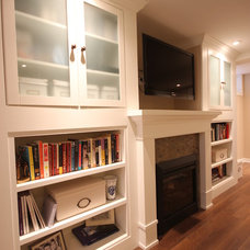 Traditional Basement by OakWood Renovation Experts