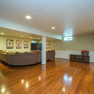 Photo of a large traditional look-out basement in Other with beige walls, dark hardwood floors and brown floor.