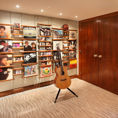 Trendy underground carpeted basement photo in Minneapolis with beige walls