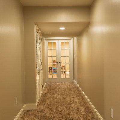 Inspiration for a timeless carpeted basement remodel in Philadelphia with beige walls and no fireplace