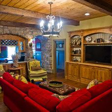 Rustic Basement by Ashley Taylor Home LLC