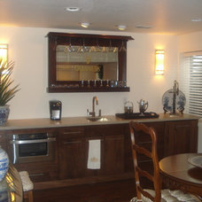 Traditional Basement by Armstead Construction Inc.
