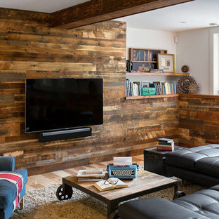 Example of an urban medium tone wood floor and beige floor basement design in Denver with white walls