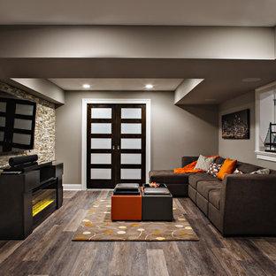 Large trendy underground dark wood floor and brown floor basement photo in New York with beige walls