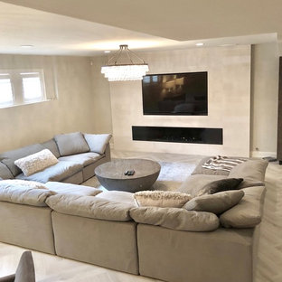 Inspiration for a mid-sized modern underground porcelain floor and gray floor basement remodel in Chicago with beige walls, a standard fireplace and a stone fireplace