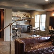 Midcentury Basement by Romanelli & Hughes Custom Home Builders
