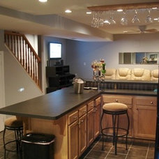 Contemporary Basement by P. L. Johnson Construction, Inc.
