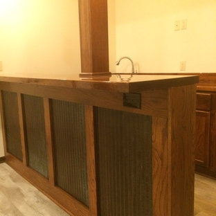Inspiration for a mid-sized craftsman underground carpeted basement remodel in Other with beige walls and no fireplace