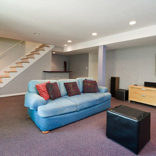 Photo of a medium sized traditional fully buried basement in Kansas City with grey walls, carpet, no fireplace and purple floors.