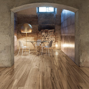 Inspiration for an industrial basement in London with grey walls and medium hardwood flooring.
