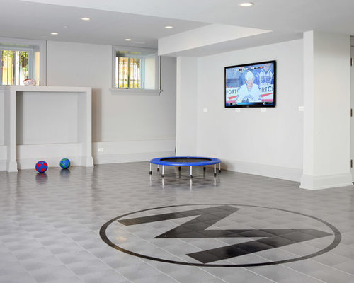 Example Of A Trendy Look Out Ceramic Floor Basement Design In Chicago With  White Walls