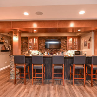 Basement - large craftsman look-out vinyl floor and brown floor basement idea in Chicago with beige walls and no fireplace