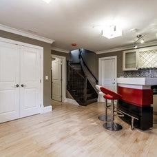 Modern Basement by Angle Construction Co Inc.