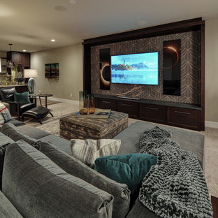 This is an example of a mid-sized midcentury look-out basement in Omaha with beige walls, carpet, no fireplace and beige floor.